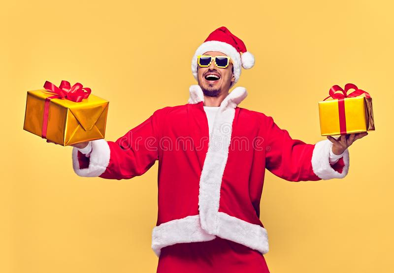 Santa Claus.Young Happy Santa Man, Christmas Gifts stock images