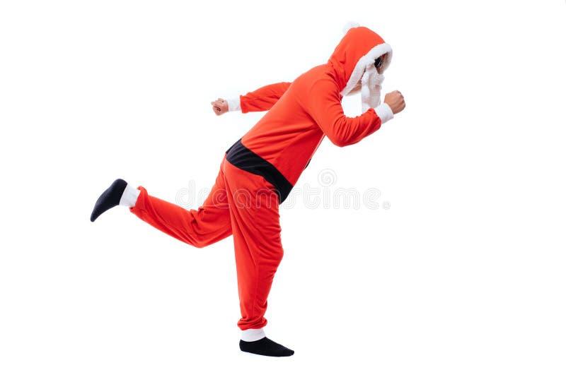 Santa Claus running on white background. Young Happy Santa Man. Emotional Confident Santa Claus Having Fun. New Year. stock image