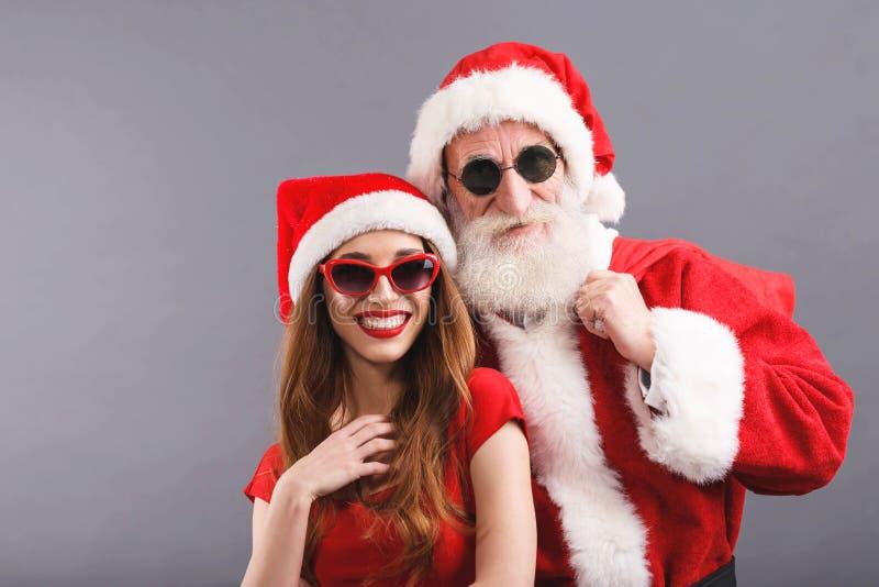 Santa Claus And Young Mrs Fundo de Claus Standing On The Gray fotos de stock