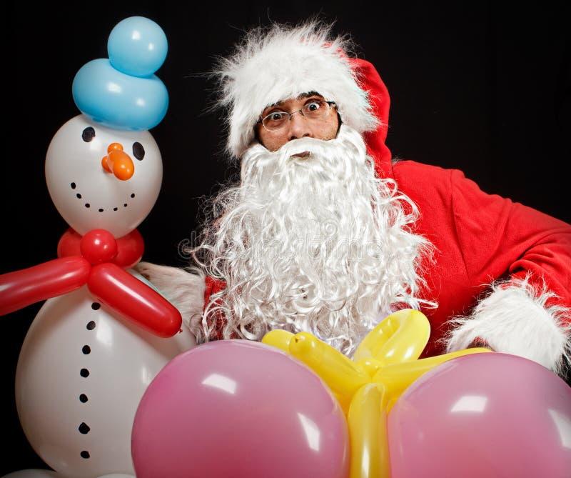 Santa Claus z balonowymi prezentami obraz royalty free