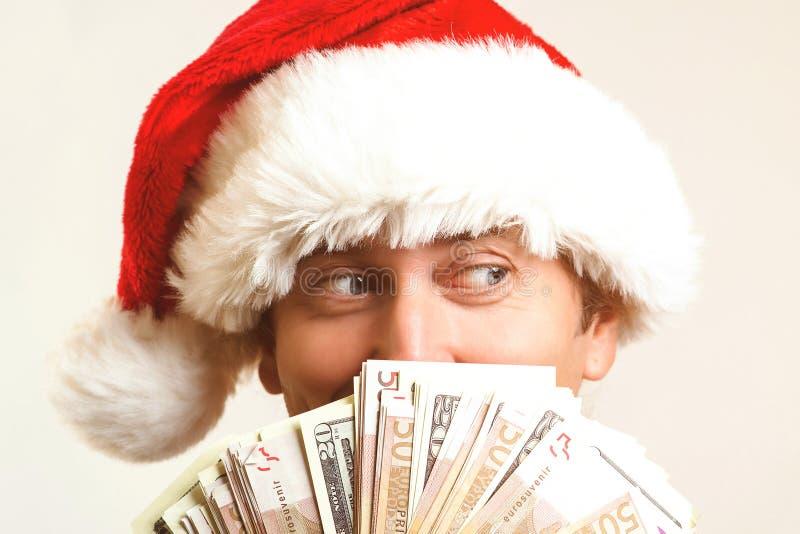 Santa Claus z dolarowym pieniądze, odizolowywającym na bielu Boże Narodzenia, wakacje, wygrywać, waluta i ludzie pojęć, Santa mie obraz stock