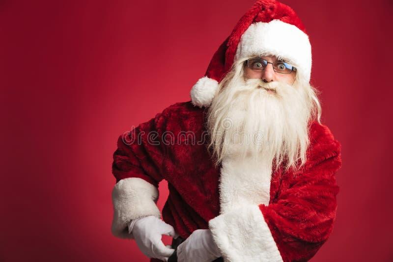 Santa Claus załatwia jego pasowego obrazy stock