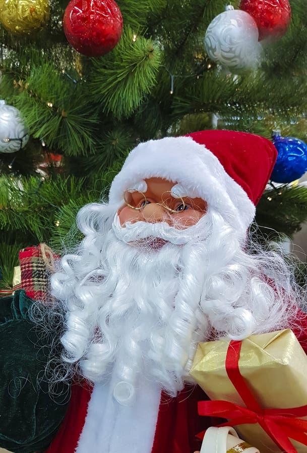 Santa Claus zabawki teraźniejszości choinki sezonu świętowanie obraz royalty free