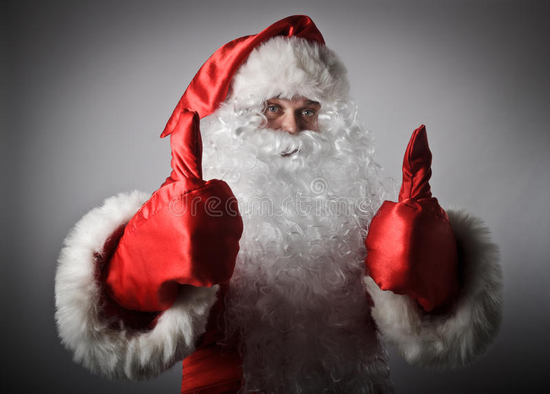 Santa Claus zeigt sich Daumen stockfotografie