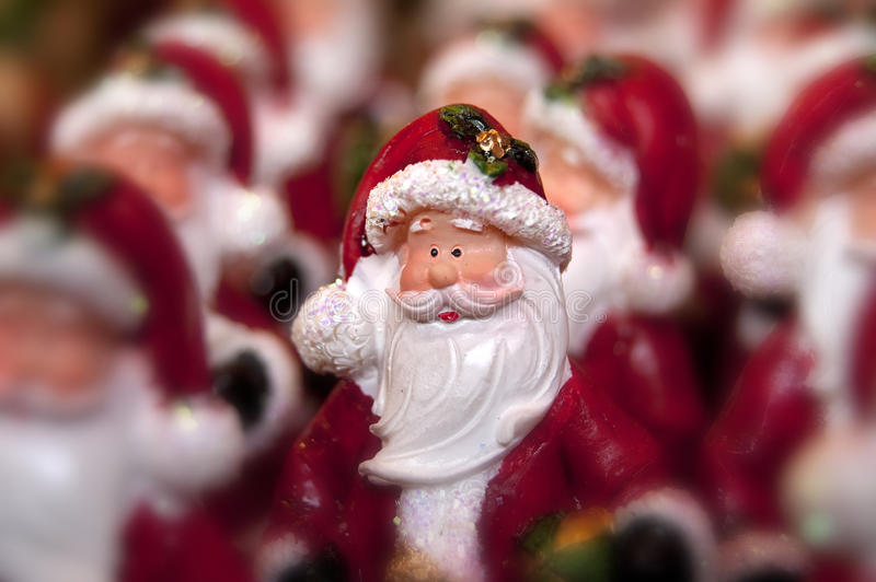 Santa clause. Many little statue of santa clause and one in focus royalty free stock photography