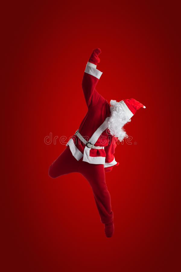 Santa Clause. Dancer Red background stock photo