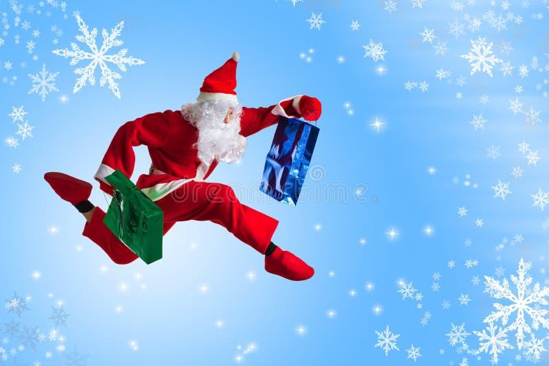 Santa Clause. Dancer blue background stock photos
