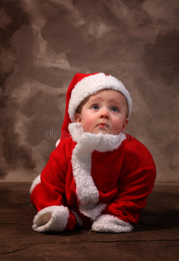 Santa clause baby. Baby in santa clause suit, traditional portrait of young toddler dressed as father christmas royalty free stock images