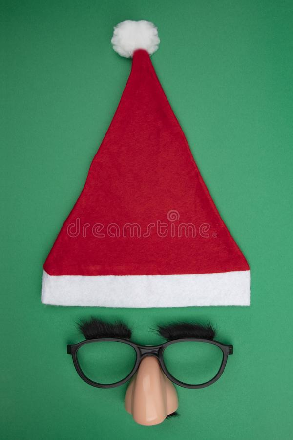 Santa Clause cap with funny mask royalty free stock photography