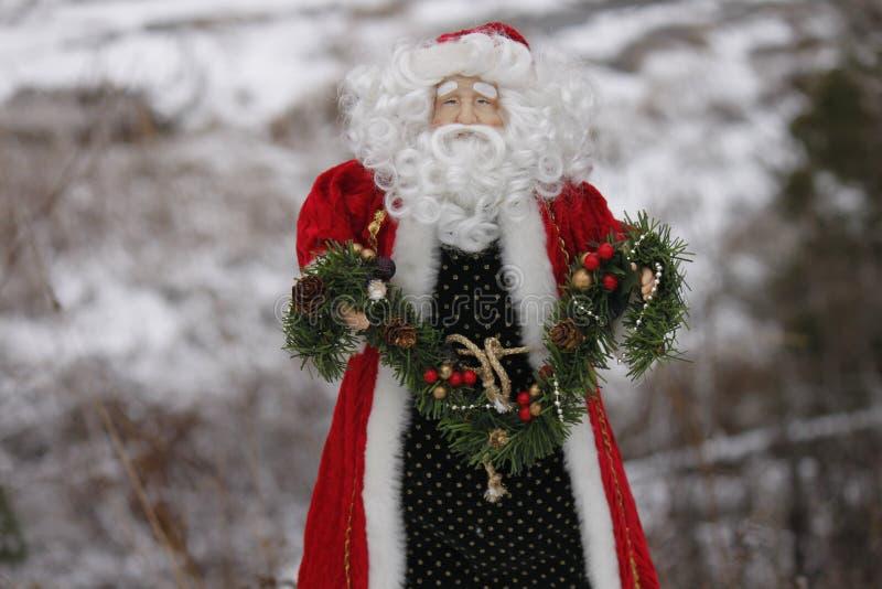 Santa Clause decoration. Holding garland stock photography