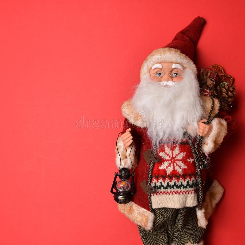 Santa Clause doll with blank space on red background - Perfect for Christmas or New Year text royalty free stock photos