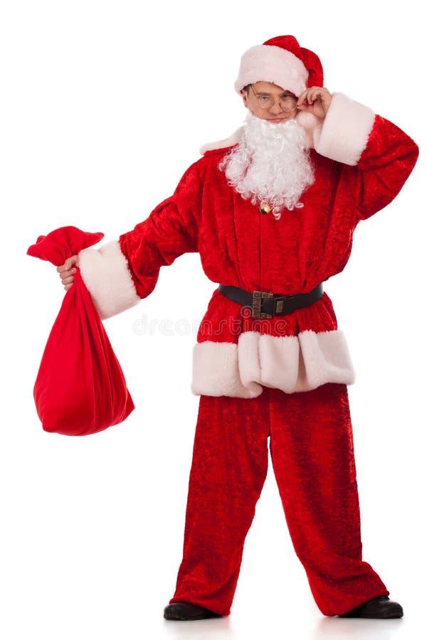 Download Santa Clause Looking At Small Sack Stock Image - Image: 26998459
