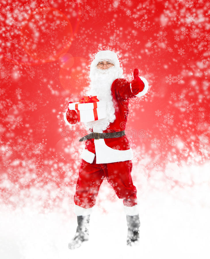 Santa Clause. In new year costume over red christmas background stock photo