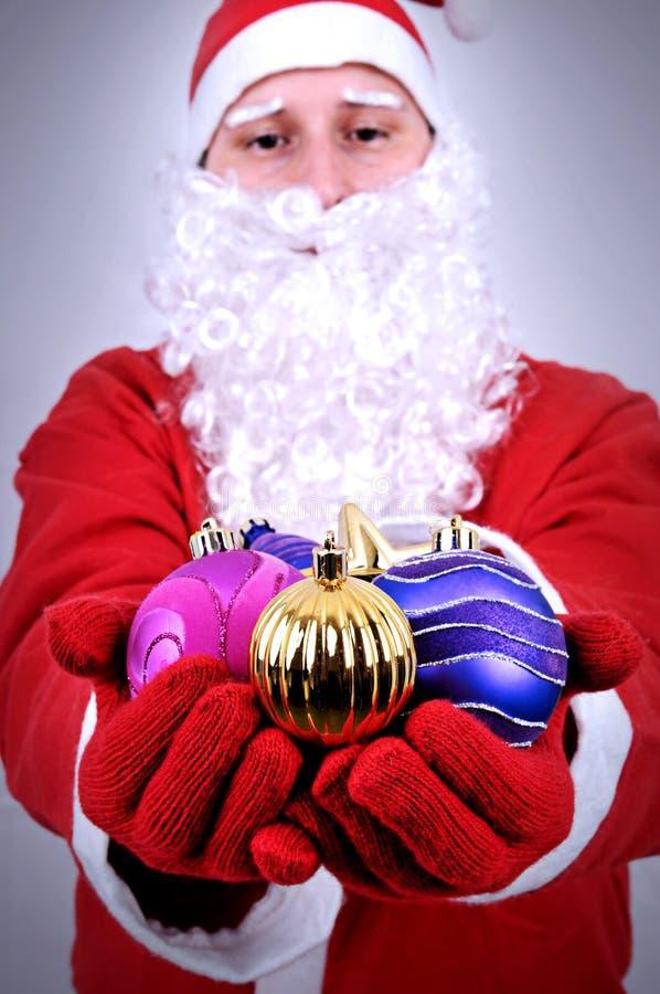 Santa Clause Showing julboll arkivbild