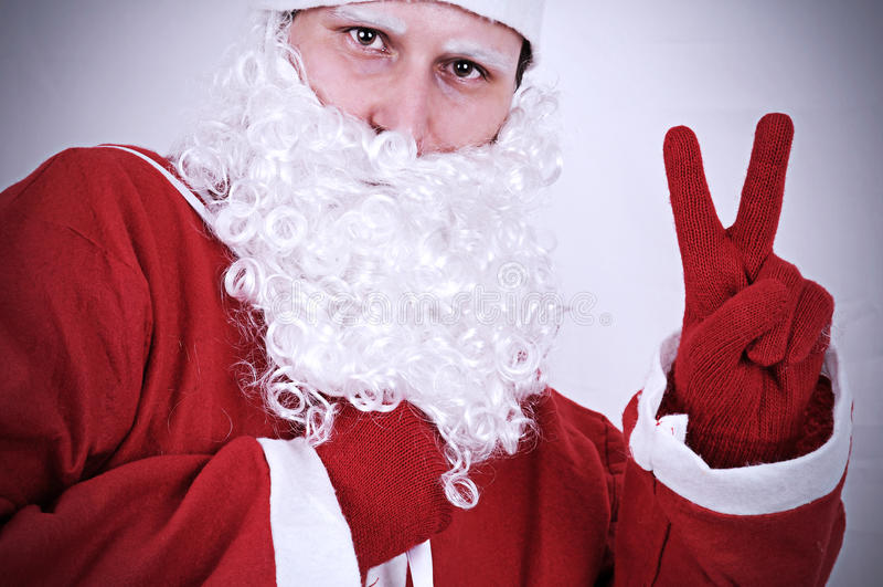 Santa Clause Showing Peace Sign arkivbilder
