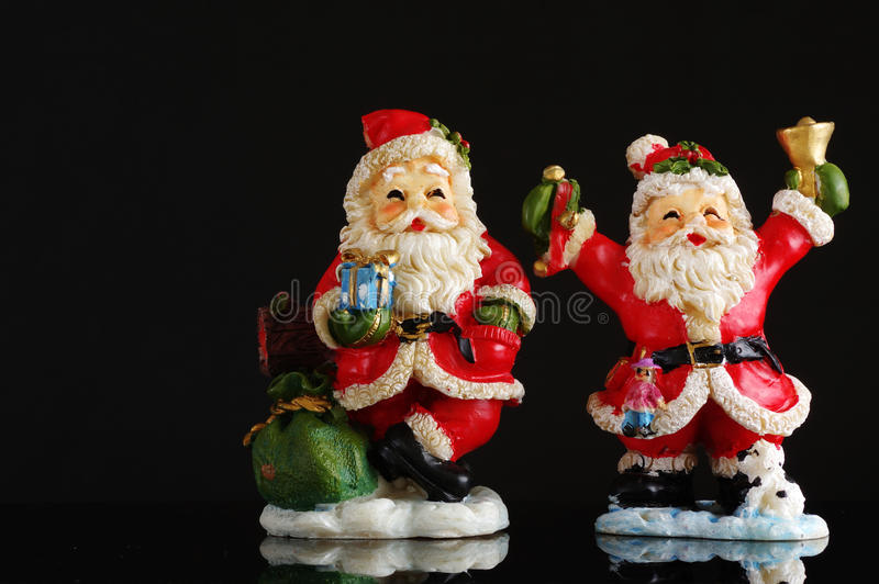 Santa Clauses black background. Objects stock photos