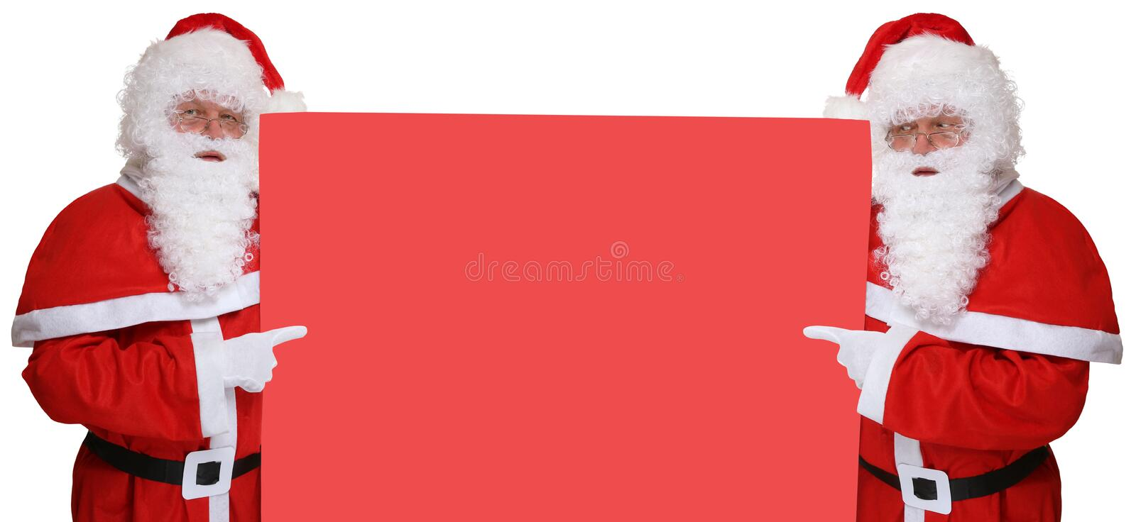 Santa Clauses with hat pointing on Christmas at empty banner wit. H copyspace for your own text royalty free stock images