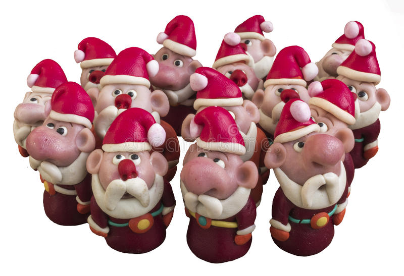 Santa Clauses from modeling clay. Santa Clauses on a white background stock photos