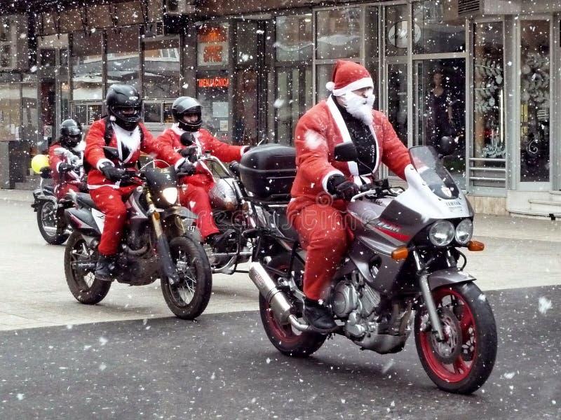Santa Clauses on motorcycles. Novi Sad, Serbia, December 26th 2010. - Santa Clauses on motorcycles delivering humanitarian aid for children royalty free stock image