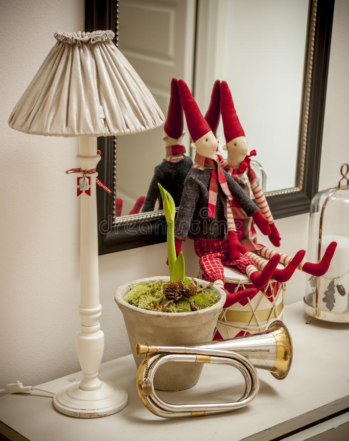 Santa Clauses on shelf. Wit a lamp and a trumpet stock photos