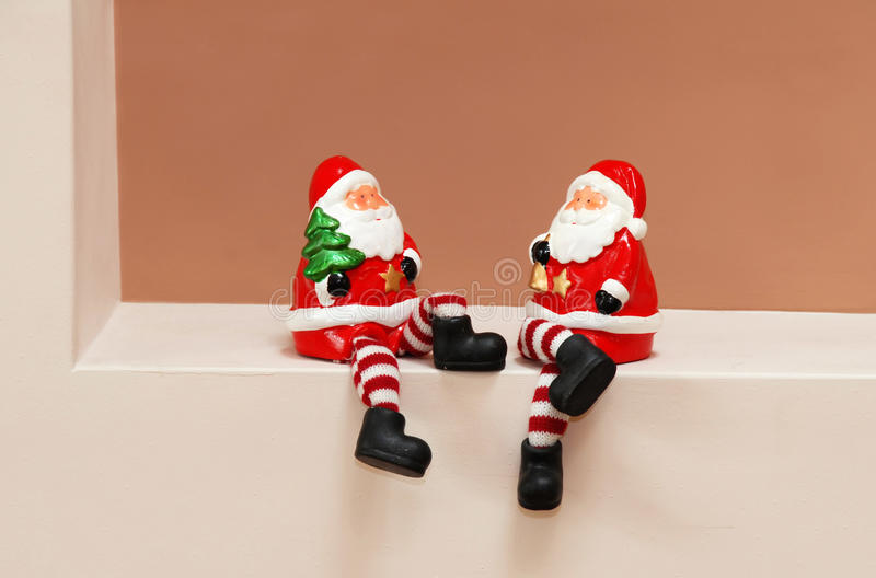 Santa Clauses toys. Two red porcelain Santa Clauses toys sitting royalty free stock image