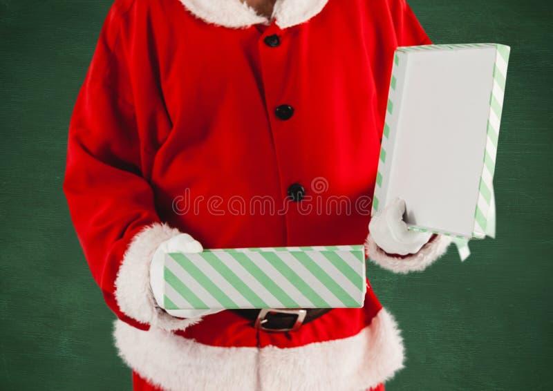 Santa clausholding a gift box. Santa claus holding a opened gift box royalty free stock photos
