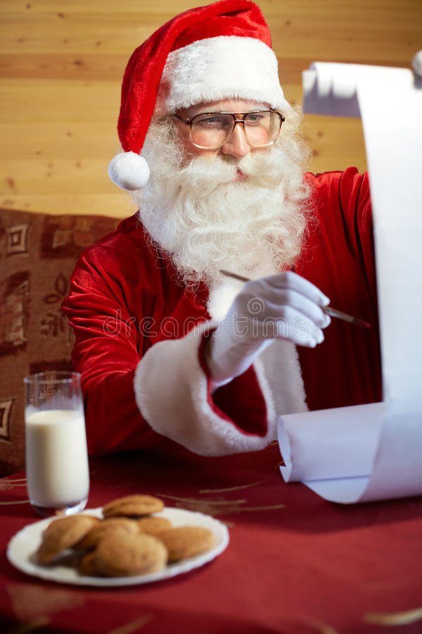 Santa Clauss-lijst stock fotografie