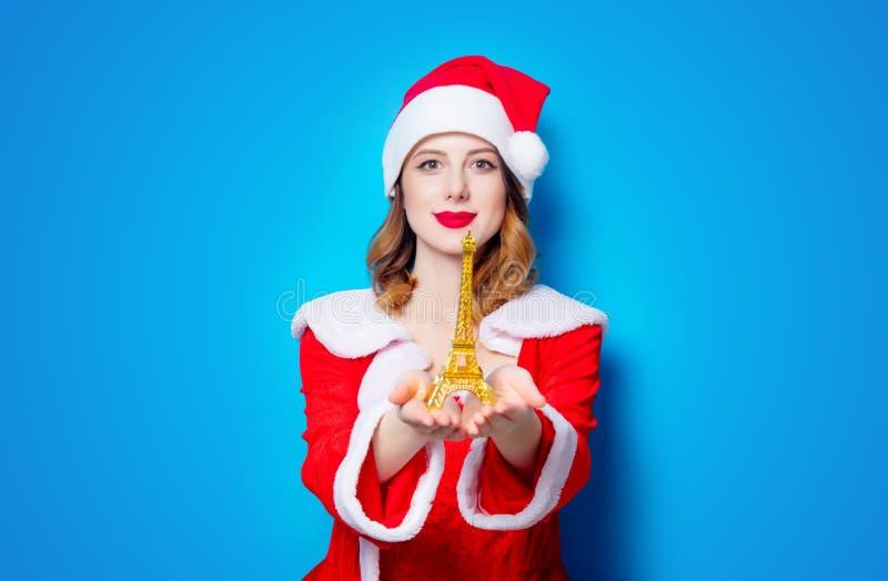 Santa Clous-meisje met de torengift van Eiffel royalty-vrije stock fotografie