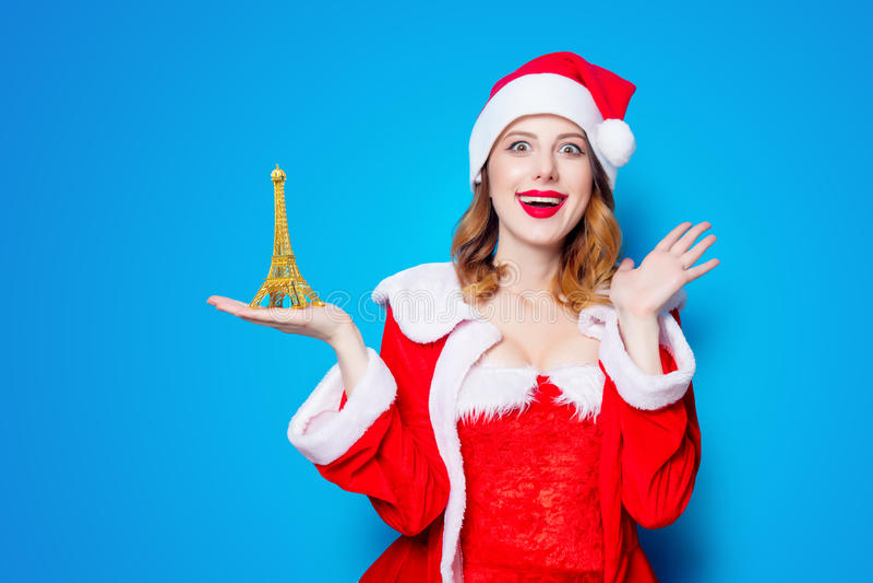 Santa Clous-meisje met de torengift van Eiffel stock foto
