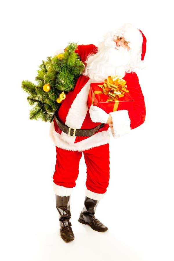 Santa com a árvore do presente e de Natal foto de stock royalty free