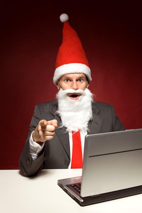 Santa com portátil foto de stock
