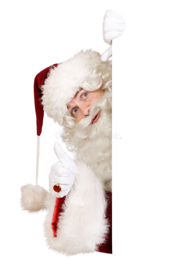 Santa con il pollice sulla bandiera immagini stock