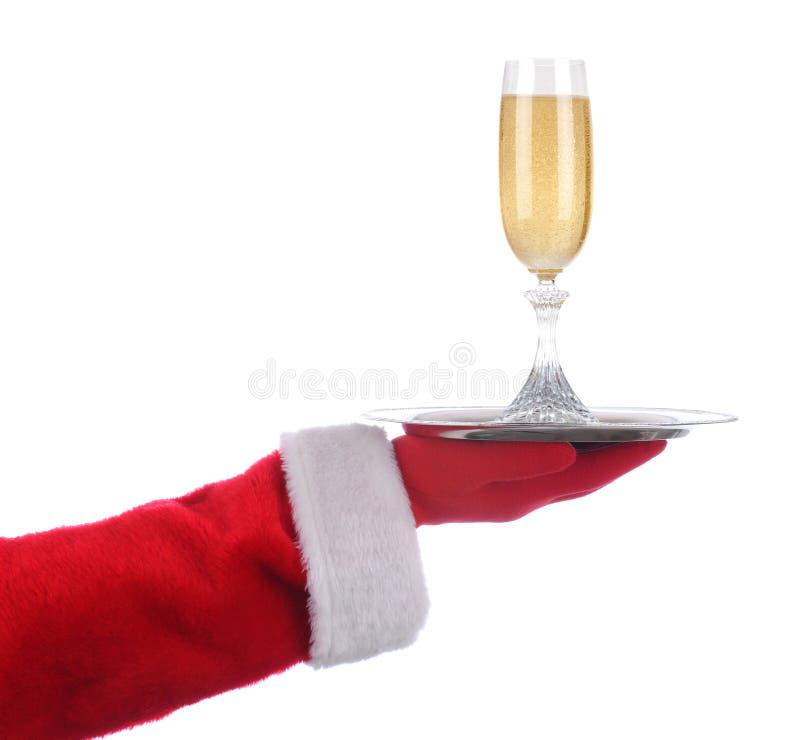 Santa con il vetro di Champagne sul vassoio fotografia stock libera da diritti