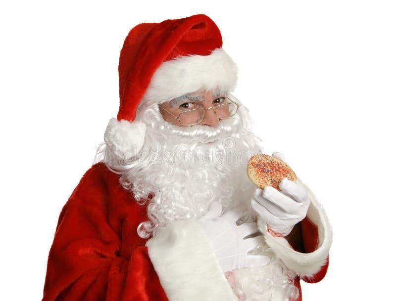 Santa con la galleta de la Navidad foto de archivo