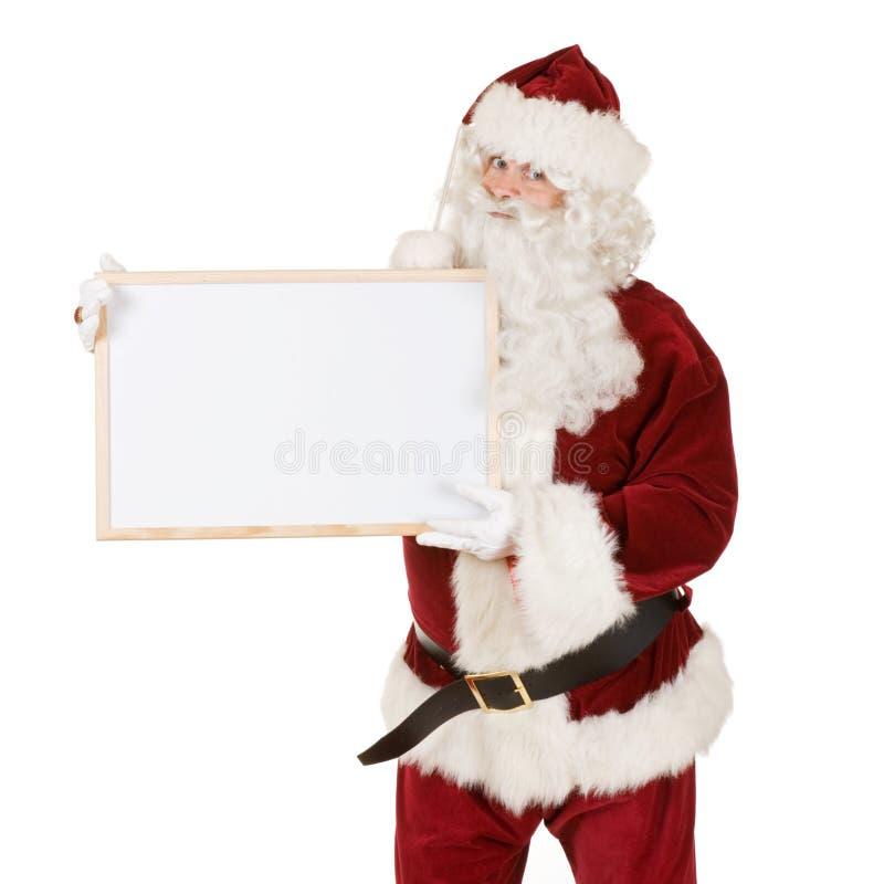 Santa con la muestra en blanco imagenes de archivo
