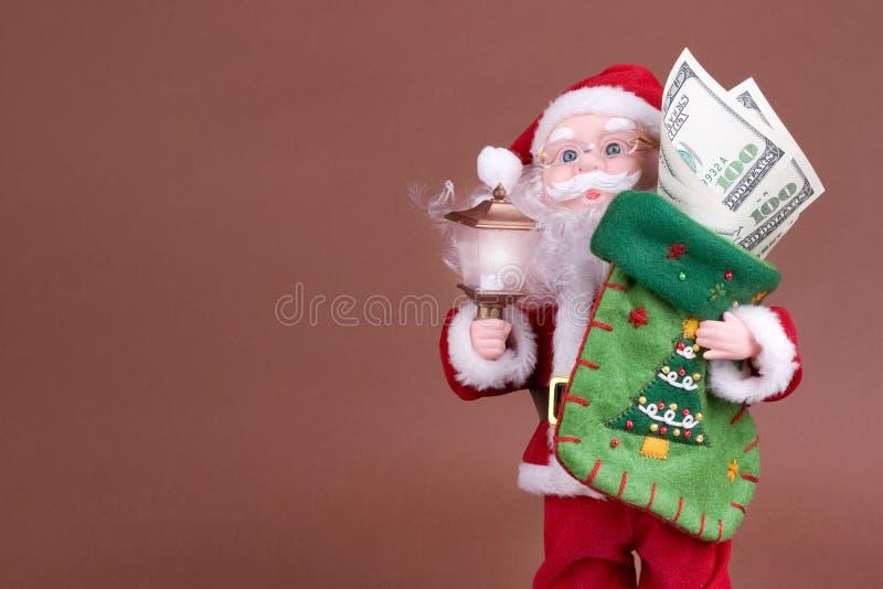 Santa con soldi fotografia stock libera da diritti