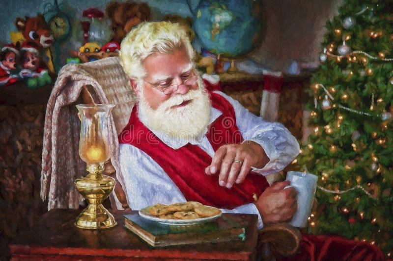 Santa with Cookies and Hot Chocolate stock photos