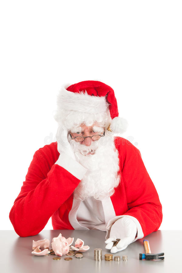 Santa counting coins. Santa had broken his piggy bank and is counting poor money stock photo