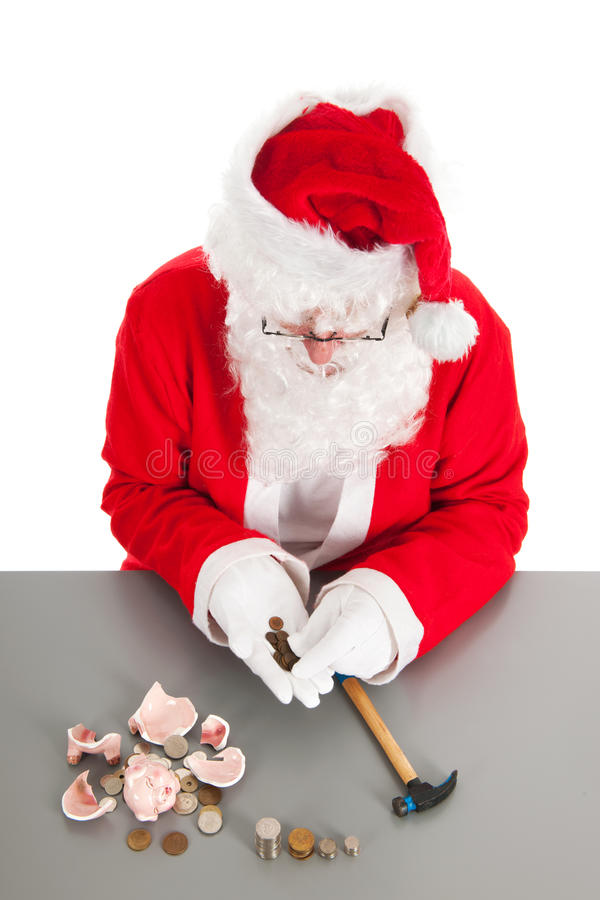 Santa counting coins. Santa had damaged his piggy bank and is counting poor money royalty free stock photos