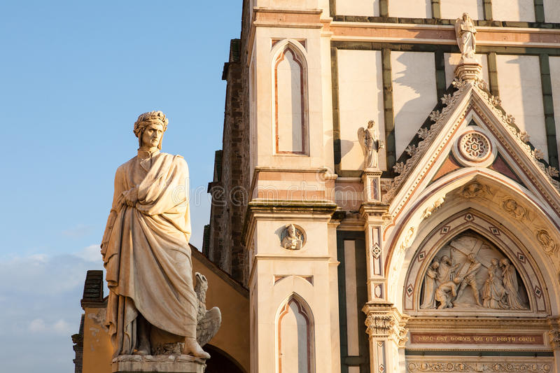 Santa Croce church and Dante, Florence, Italy. The facade of the Santa Croce basilica completed in the 14th century together with the 19th century statue of royalty free stock photo