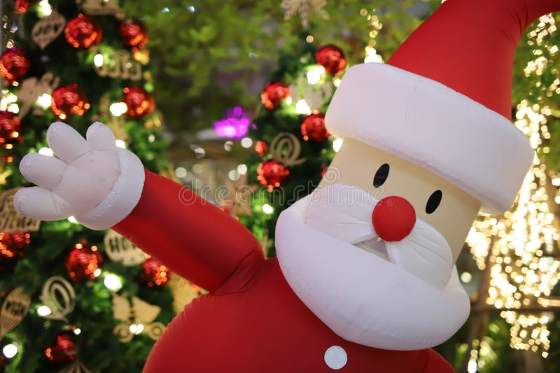 Santa Cross Inflatable Doll. Is waving hands stock image
