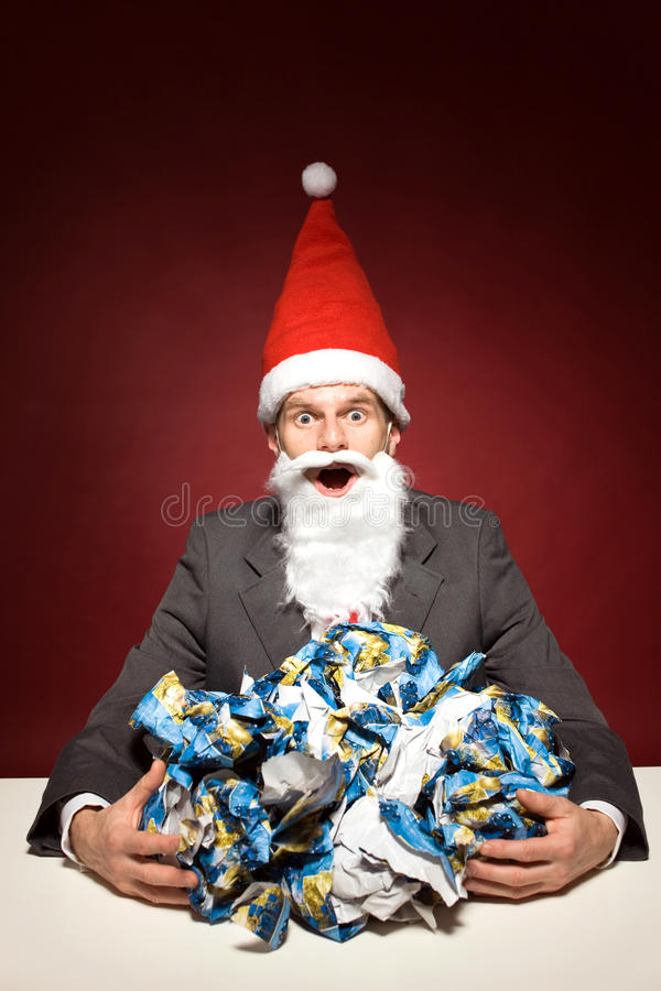 Santa with crumpled paper stock image
