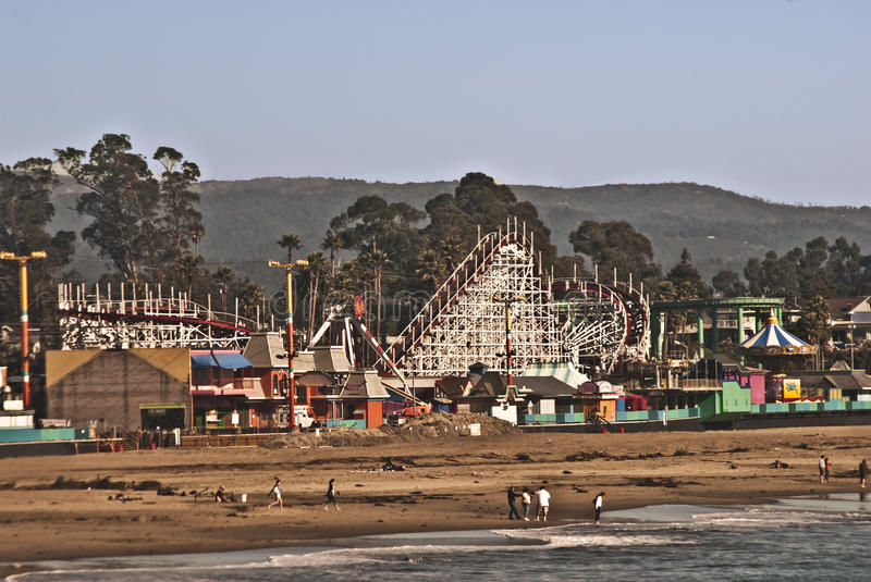 Santa Cruz Beach and Boardwalk. This is a view of the famous Santa Cruz beach and boardwalk with a classic landmark wooden roller coaster on the Monterey Bay royalty free stock photography