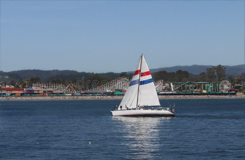 Santa Cruz beach boardwalk and sail boat royalty free stock images