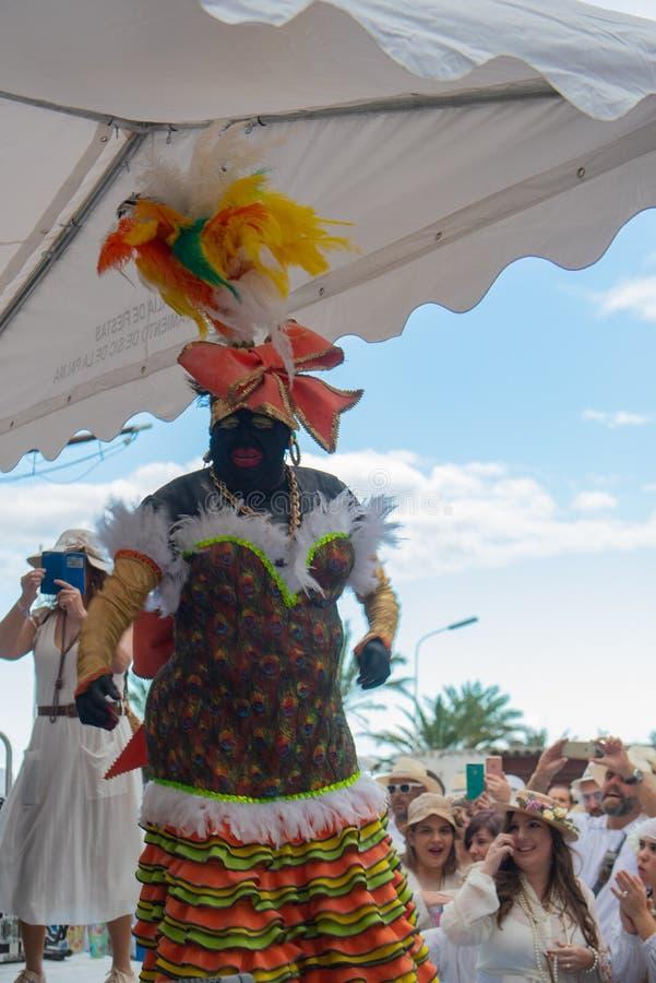 SANTA CRUZ DE LA PALMA, CANARY ISLANDS, SPAIN - MARCH 04, 2019: La Negra Tomasa Dance during Los Indianos Carnival Party royalty free stock photo