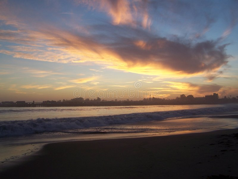 Santa Cruz Sunset. Beautiful sunset shot with gorgeous colors set in the clouds at the beach royalty free stock photos