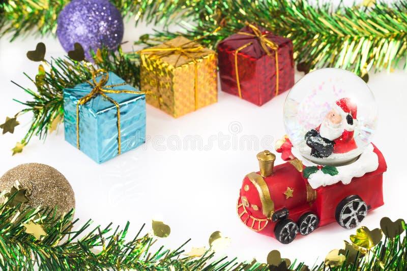 Santa Crystal snow ball on Christmas background stock photos