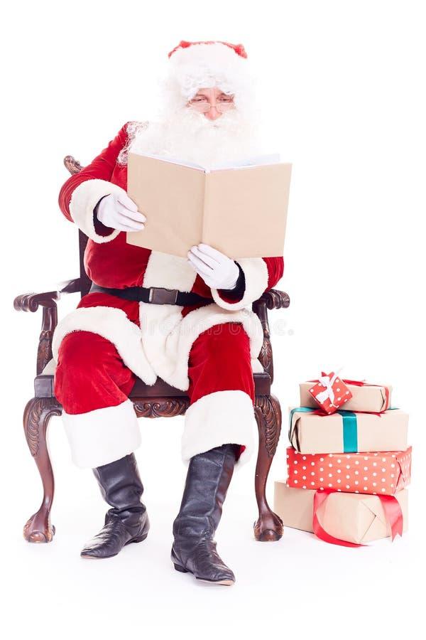 Santa czytelnicza bajka fotografia royalty free