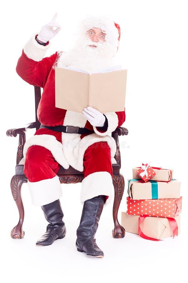 Santa czytelnicza bajka fotografia stock