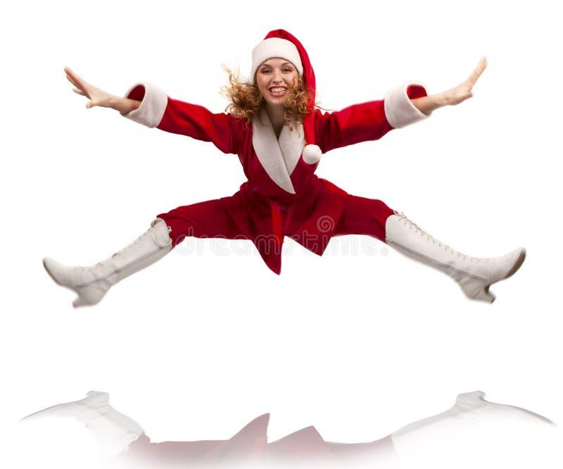 Santa de danse heureuse branchant dans le ciel image stock